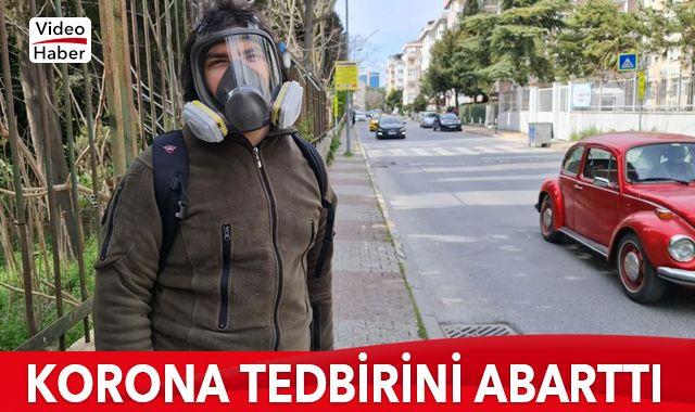 Tedbiri abarttı, dışarı gaz maskesiyle çıktı