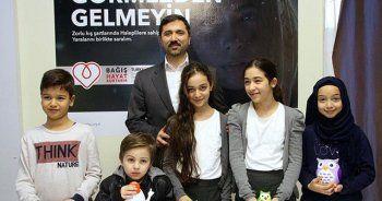 Köln'de çocuklar harçlıklarını Haleplilere gönderdi