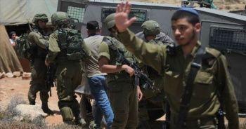 İsrail güçleri 12 Filistinliyi gözaltına aldı