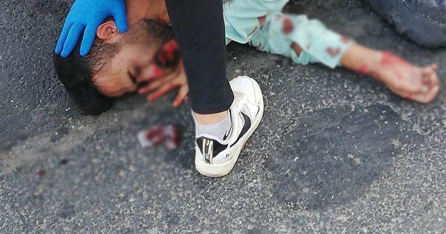 Otobüsün altında kalan motosikletli genç ağır yaralandı