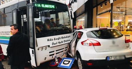 Otobüsün sürüklediği otomobil mağazaya girmekten son anda kurtuldu