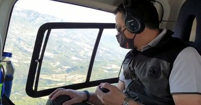 Bakan Pakdemirli, sabah saatlerinde helikopterle yangın bölgesini inceledi