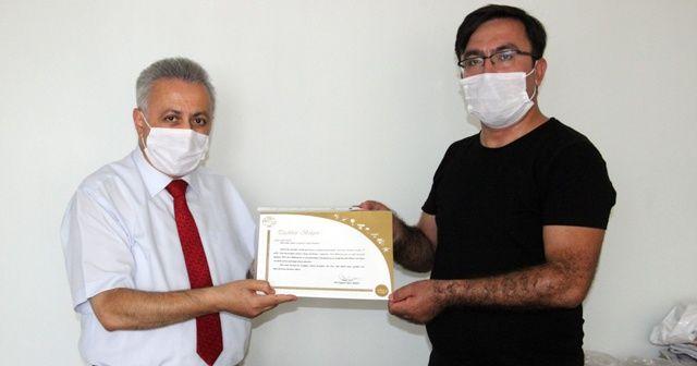 THK'dan İHA Muhabirine teşekkür belgesi