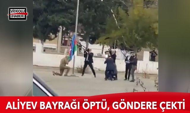 Aliyev, Azerbaycan bayrağını öperek göndere çekti
