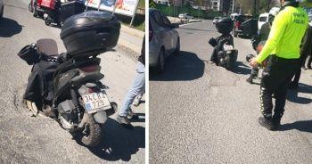 İstanbul'da ilginç kaza: Motosikletli kurye rögara düştü