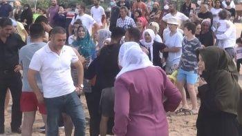 Dalgalar arasındaki cismi ceset sanan acılı aileyi Jandarma sudan güçlükle çıkardı