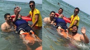 Engelli vatandaş hayatında ilk kez denizin keyfini çıkardı