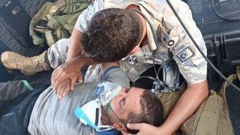 Milas'ta yangında mahsur kalan kişi helikopterle kurtarıldı