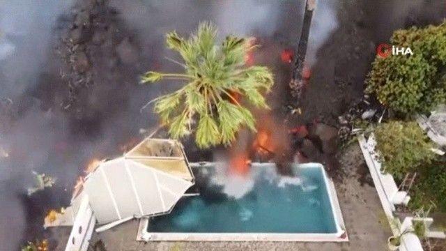 Dehşet görüntüler: Yanardağdan akan lavlar havuzu doldurdu