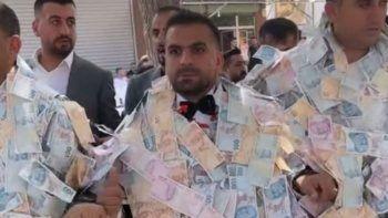 Damat paraları taşımakta zorlandı
