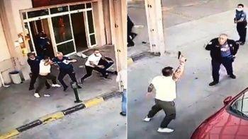 Hastane önünde korkutan anlar: Polisin belinden silahı aldı ateş etti
