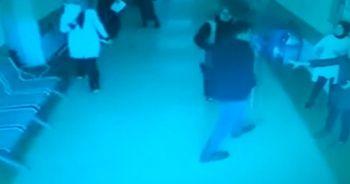 Eşine bağırdığını iddia ettiği doktorun odasını fırçayla basan şahıs kamerada