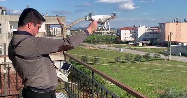 Evden çıkamadı, alışveriş için evden markete drone yolladı