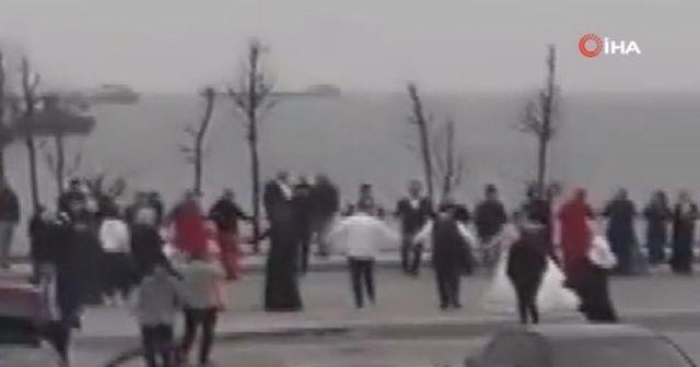 Yetkililer 'evde kal' uyarısı yaptı, gelin ve damat sahilde halay çekti