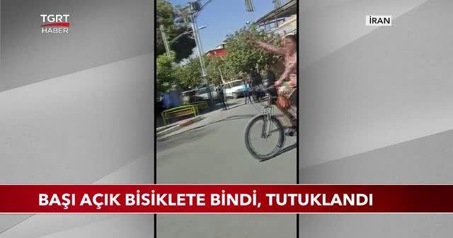 Başı açık bisiklete bindi, tutuklandı
