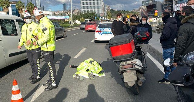 Trafik polisinden yaralı genç kıza insanlık örneği