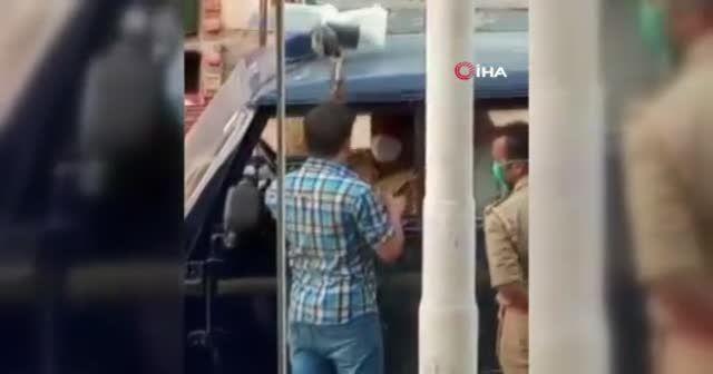 Maske takmadığı için ceza kesen polise tokat attı
