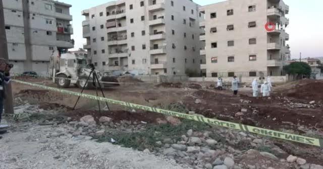 Afrin'de toprağa gömülü 35 kişinin cansız bedeni bulundu