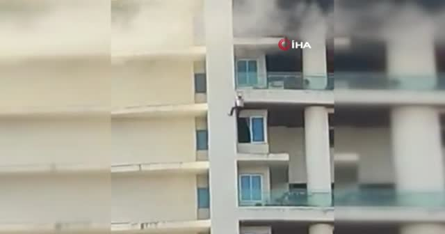 Yangından kaçmak için 19. kattan sarktı yere düştü
